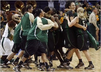 Baylor's Brittney Griner, No. 42 at right, celebrated with teammates including Melissa Jones, No. 5, after Baylor beat Duke 51-48 in the NCAA Memphis Regional championship.