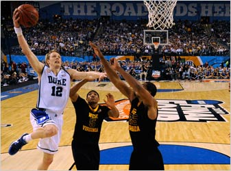 Duke's Kyle Singler (12) shoots over West Virginia's Kevin Jones (5) and Wellington Smith during the first half.
