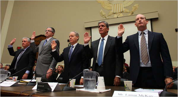 Big oil company executives take their oath before Congress
