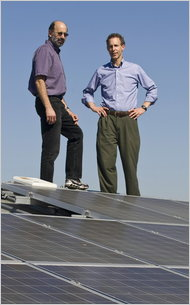 Dan W. Reicher, right, with Bill Weil, another Google energy executive, on the solar roof of Google headquarters in Mountain View, Calif.