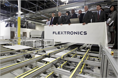 Officials including Energy Secretary Steven Chu, far left, and Gov. Jerry Brown of California, second from left, dedicating a new solar panel factory in Milpitas, Calif., this week.