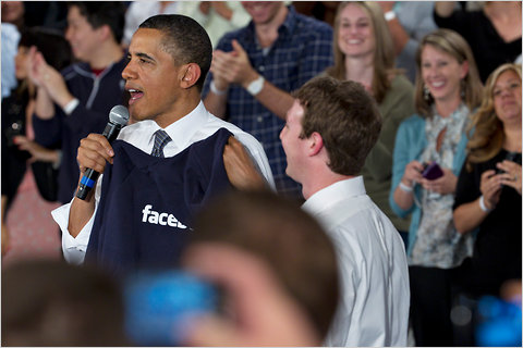 President Obama with a sweatshirt given to him by Mark Zuckerberg,<br /> the founder of Facebook, at a townhall meeting in Palo Alto, Calif., on<br /> Wednesday.