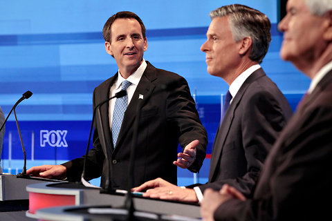 Former Gov. Tim Pawlenty of Minnesota, left, at Thursday's debate in Ames, Iowa, with Jon M. Huntsman Jr. and Newt Gingrich.