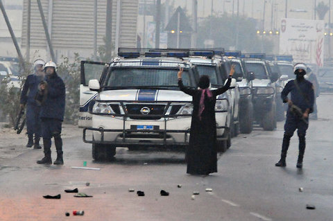 Bahrain woman stops police