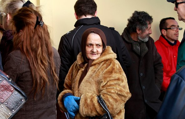 As austerity bites, applicants lined up outside a welfare office in an Athens suburb on Friday.