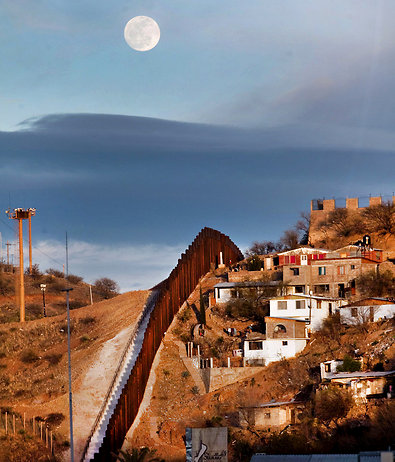 A fence divides Nogales, Ariz. (left), from Nogales, Mexico.
