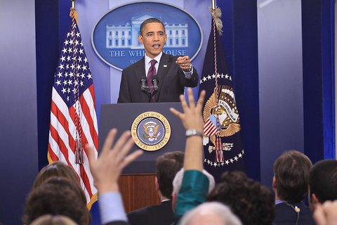 President Obama responding to questions from reporters at a news conference in Washington.