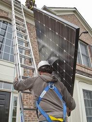 Installing solar panels on a home in Belmar, N.J.