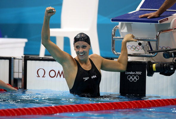 Dana Vollmer celebrated after setting a world record in the 100-meter butterfly on the way to winning an Olympic gold medal.