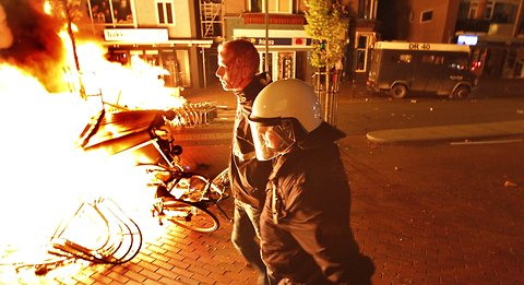 Riot place faced a crowd that turned violent in Haren, The Netherlands, late Friday after thousands were drawn to the town by a birthday party invitation on Facebook that went viral.
