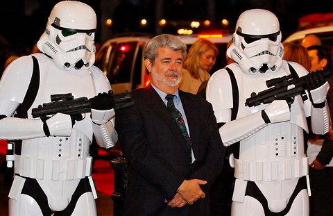 George Lucas in 2005, flanked by stormtroopers from his