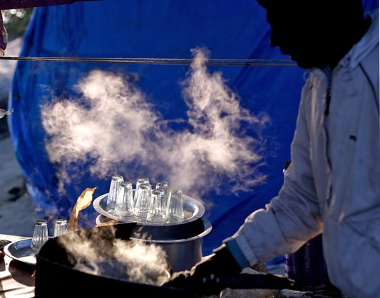 Hot tea being prepared at a tea stall on the banks of Yamuna River, on a winter morning in New Delhi. The minimum temperature in parts of the capital dropped to 10 degrees Celsius (50 degreesFahrenheit)on Wednesday, according to the meteorological department.