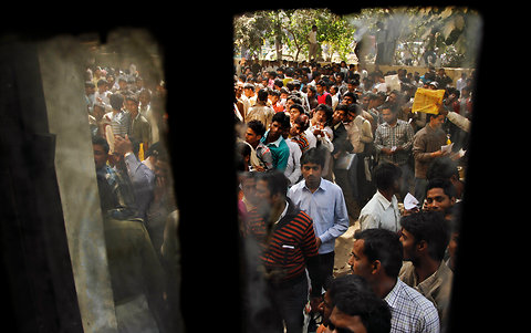 Unemployed men waiting to register themselves at the Employment Exchange Office in Allahabad, Uttar Pradesh, in this Feb. 29, 2012 file photo.