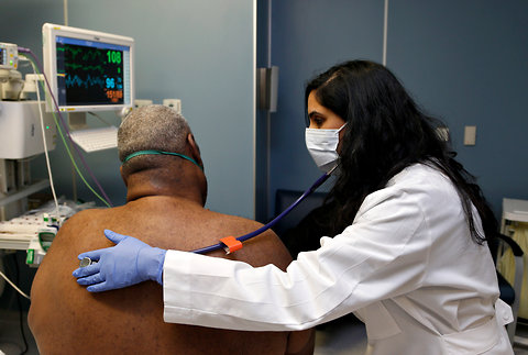 Dr. Meeta Khan wearing a face mask as she examined a respiratory patient at Rush University Medical Center in Chicago on Thursday.