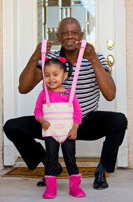 Jeffrey Nash, shown with Donna Sanchez, invented the Juppy, a sling that helps children learn to walk.