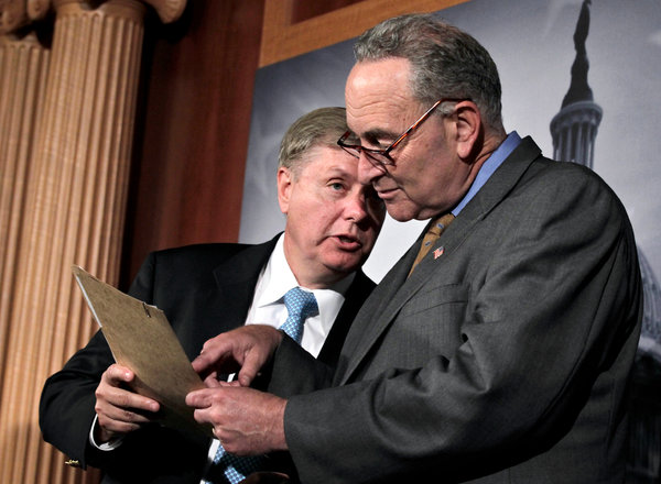 Senators Lindsey Graham, left, and Charles E. Schumer, shown in 2011, are two of the eight lawmakers behind the proposal.
