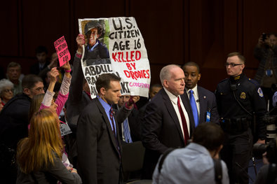 Protesters briefly disrupted the confirmation hearing for John O. Brennan, President Obama's nominee to be C.I.A. director, on Capitol Hill on Thursday.
