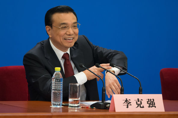 New Chinese Prime Minister Li Keqiang gestures as he attends his first press conference after the closing session of the National People's Congress at the Great Hall of the People in Beijing on Sunday.