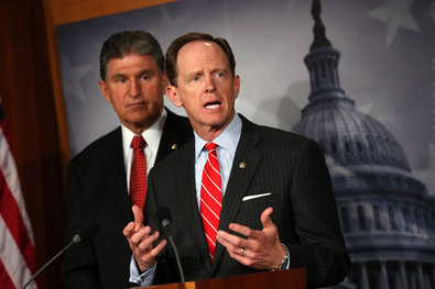 Senators Joe Manchin III, left, and Patrick J. Toomey announced on Wednesday that they had agreed on a deal on background checks for gun buyers.