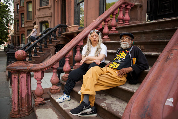 Musician and composer, Bill Lee, with wife Susan Lee, in front of their brownstone in Fort Greene Brooklyn