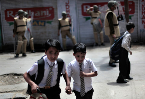 School children running for cover during a protest in Srinagar, Jammu and Kashmir, on Apr. 28, 2011.