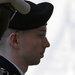 Pfc. Bradley Manning was led into court, where a judge ruled Thursday that he would face a charge of aiding the enemy.