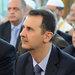 President Bashar al-Assad, center, at morning prayers marking the end of Ramadan last month.