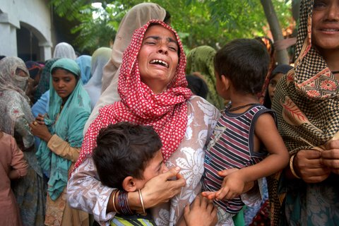 A woman, with her children, at a refugee settlement at Loi village in the district of Muzaffarnagar in Uttar Pradesh, on Monday.