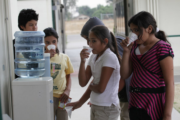 Elementary school students in Seville, Calif., take a water break. Drinking water in many parts of California's Central Valley is contaminated with arsenic.