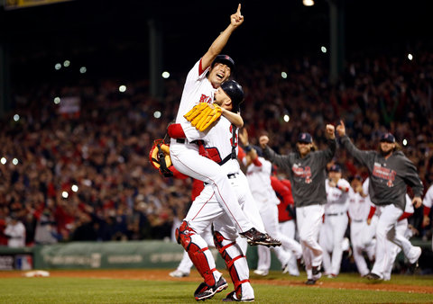 Catcher Davis Ross hoisted Koji Uehara after securing the final out of the World Series as their teammates rushed from the dugout.