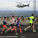 About 50,000 participants of the New York City Marathon raced over theVerrazano-Narrows Bridge under the careful watch of security on the ground and above.