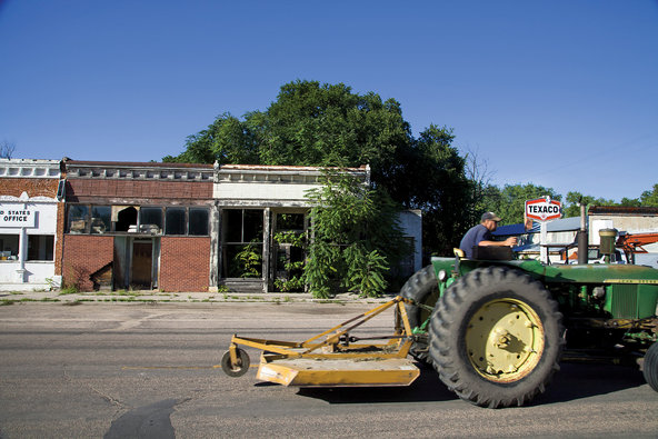 A farmer drives a tractor near Riverton, Neb., a far cry from the bustle of Payne's Hollywood life.