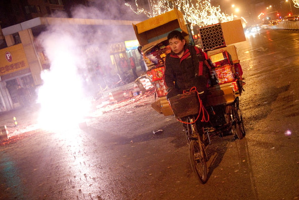 A man hauls discarded boxes of fireworks in Beijing during the Chinese New Year in 2011.