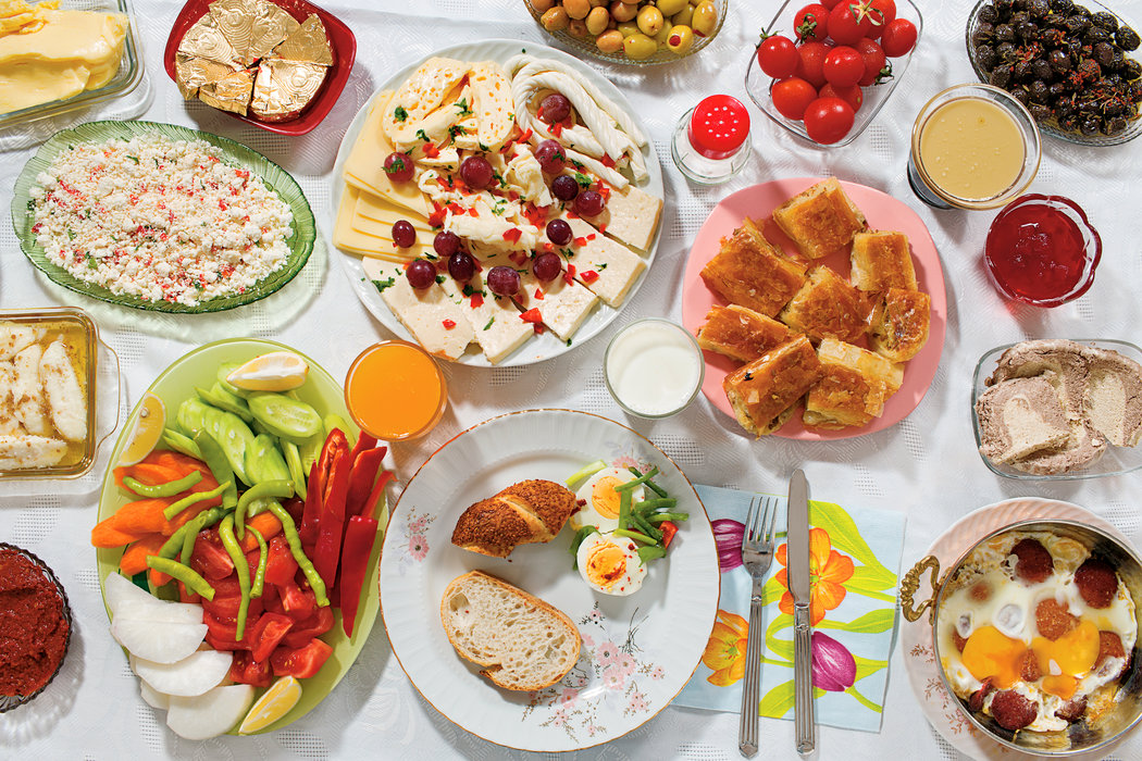 <p>The elaborate Saturday morning spread in front of Doga includes honey and clotted cream, called <em>kaymak</em>, on toasted bread; green and black olives; fried eggs with a spicy sausage called <em>sucuk</em>; butter; hard-boiled eggs; thick grape syrup (<em>pekmez</em>) with tahini on top; an assortment of sheep-, goat- and cow-milk cheeses; quince and blackberry jams; pastries and bread; tomatoes, cucumbers, white radishes and other fresh vegetables; <em>kahvaltilik</em> <em>biber salcasi</em>, a paste made of grilled red peppers; hazelnut-flavored halvah, the dense dessert; milk and orange juice. While certainly more elaborate than weekday fare, this Gursoy family meal is in keeping with the hodgepodge that is a typical Turkish breakfast.</p>