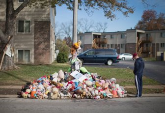 The memorial at the site of Michael Brown's shooting in Ferguson, Mo. Greg Bajema, right, said he made a side trip on his way from Dallas to Chicago to see it on Wednesday.