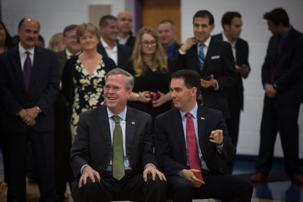 Jeb Bush and Gov. Scott Walker visited La Casa de Esperanza in Waukesha, Wis., on Monday for an event about school choice.