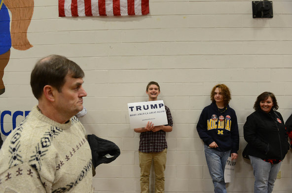 Supporters of Donald Trump hold signs at an event in Nashua, N.H.
