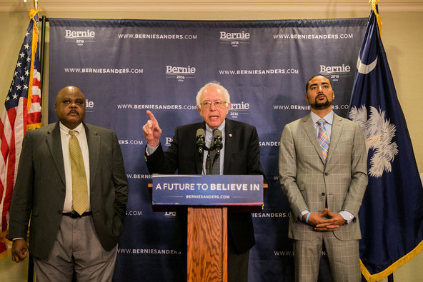 Senator Bernie Sanders, flanked by the state legislators Joseph H. Neal, left, and Justin T. Bamberg, at a news conference in Columbia, S.C., on Wednesday.