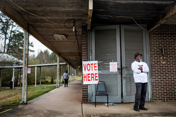 James Spraggins volunteered outside the polling station at the Muscoda Community Center in Muscoda, Ala.