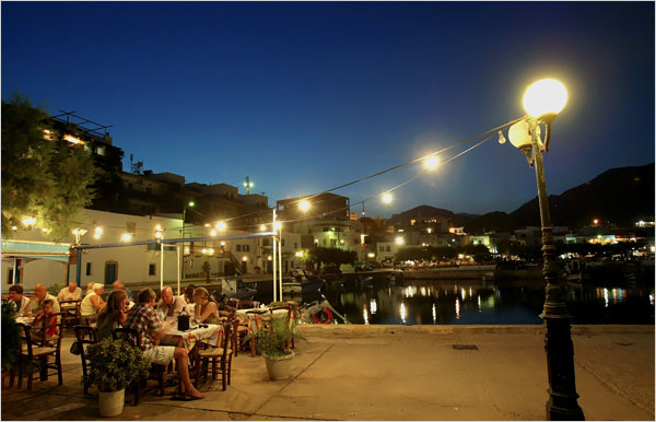 A night view of tavernas in the port of Makriyialos.