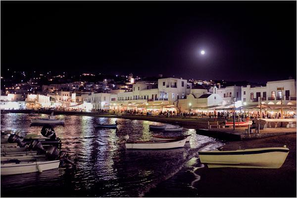 The moonlit harbor of Mykonos Town.