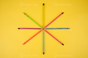 Color Pencils on Yellow Background Image