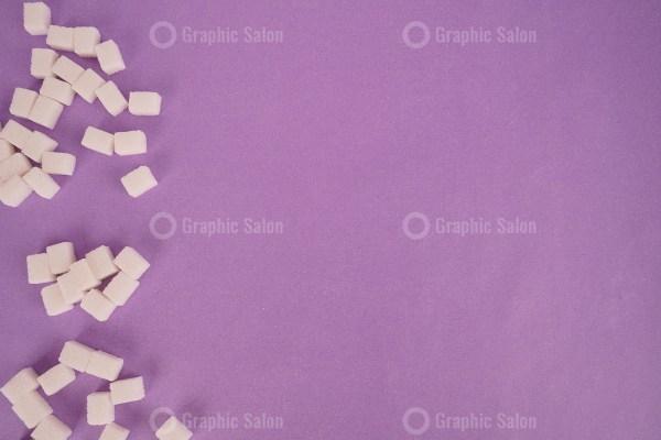 Cube sugar on purple background stock photo