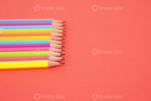 Pencils on red background stock photo