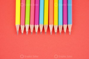 Set of pencils on red stock photo