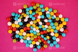 Assorted candies isolated on pink background