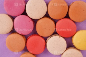 Assorted macaroons on purple background stock image