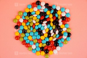 Colorful candies isolated on pink background stock photo