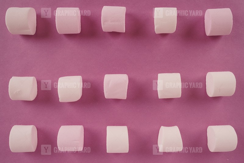 Pattern with marshmallow candies on purple stock photo