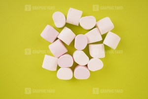 Pile of marshmallow on green background stock image